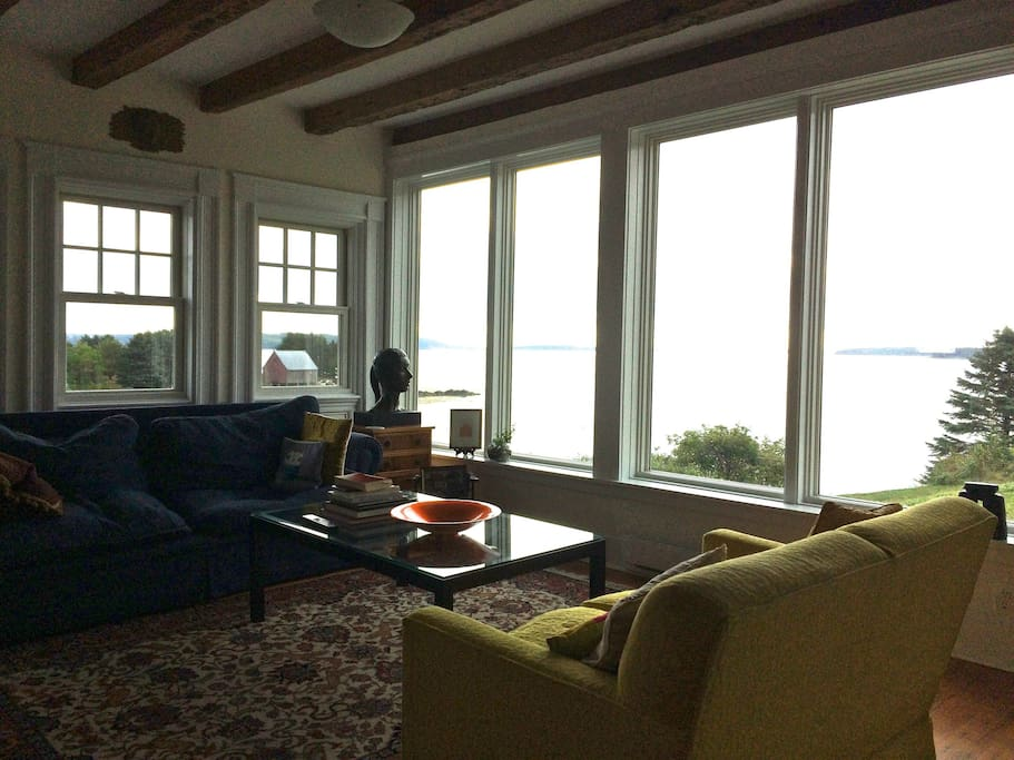 The living room enjoys a panoramic view of the ocean.