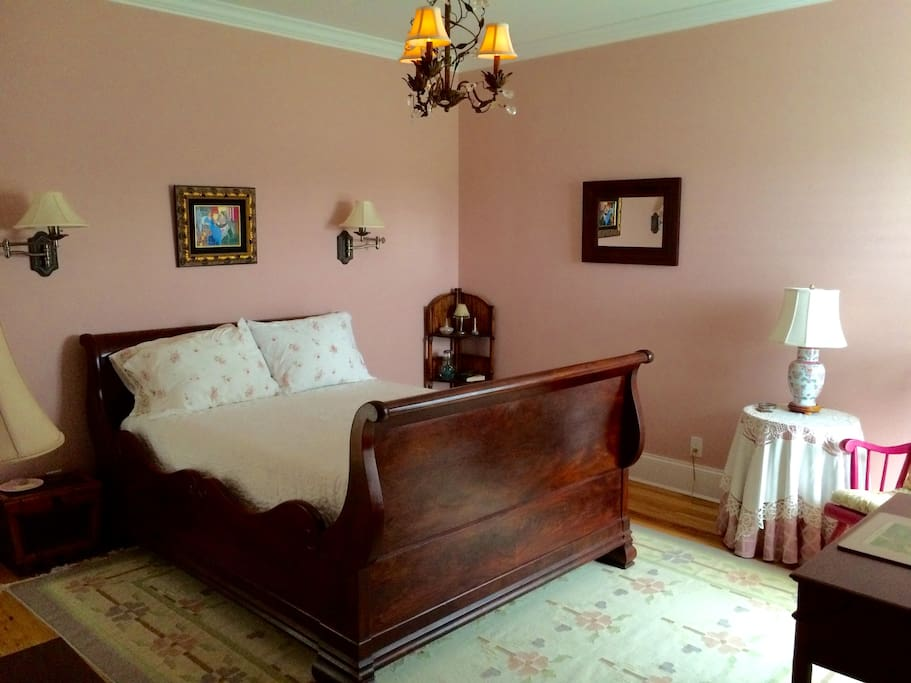 "2nd floor suite with romantic antique sleigh bed frame with memory foam comfy mattress, large private bath, dressing room and extra large private living room, just for you and your guests. ""This multi-room suite feels like you your own private residence."""