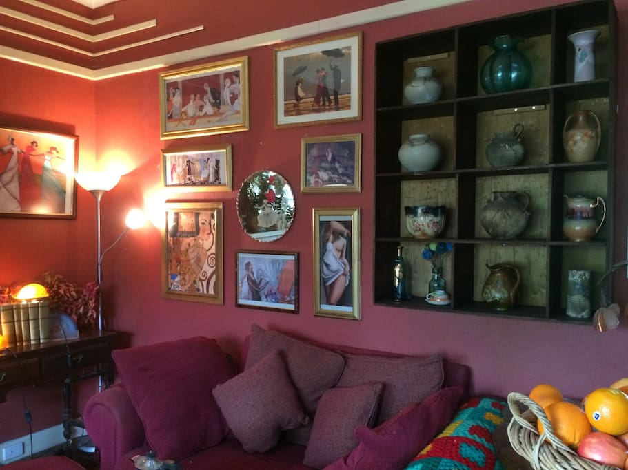 Warm, colourful and filled with vintage delights – one corner of the living room.