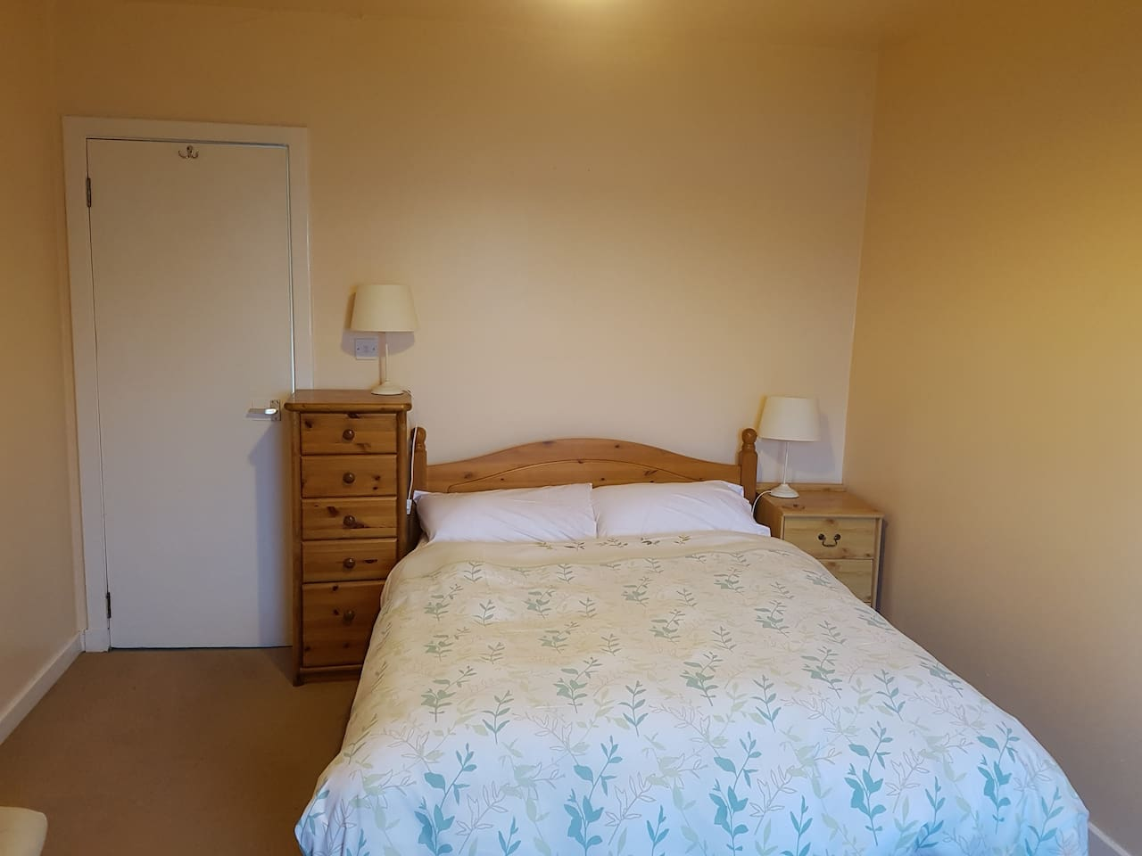 Guests enjoy a peaceful night's sleep in this comfortable bed with gorgeous views