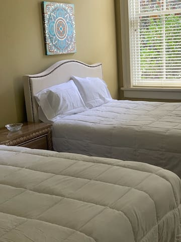 Secondary master bedroom with two queen size beds in the room.