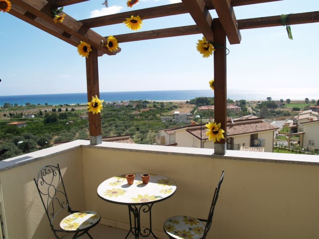 The balcony at first floor with a great view over the ocean.