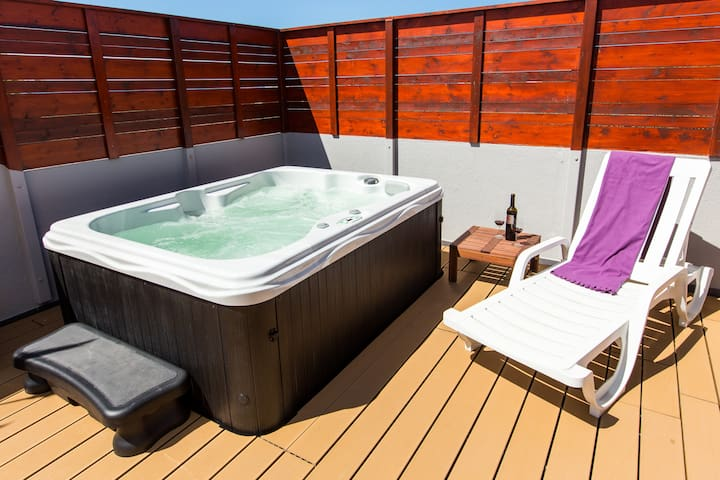 relax in private, sunny garden with jacuzzi and top quality decking