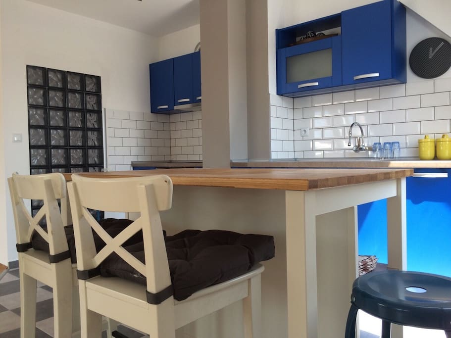 A solid kitchen island with 4 bar stools - Ikea brings the notion of home even closer:)