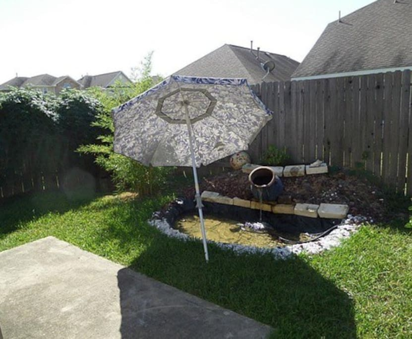 Enjoy the Texas sun on your patio with pond and waterfall