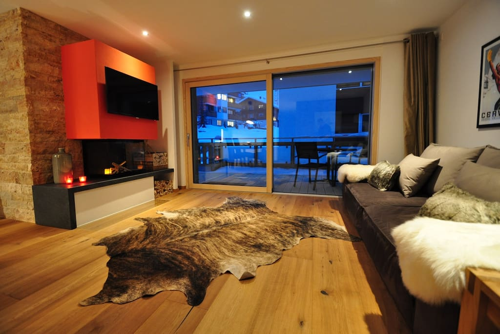 Spacious living area with fireplace.