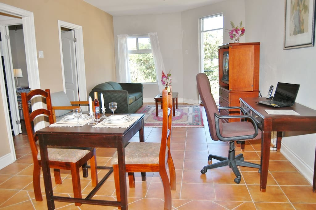 Modern & spacious living and dining areas in the 2-bedroom suite.