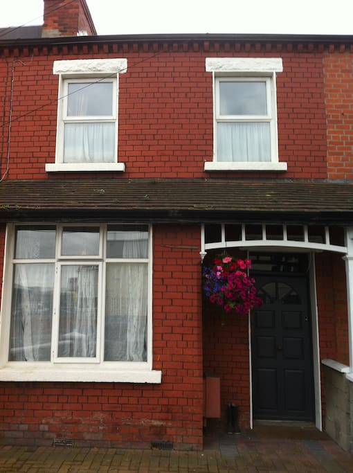 View from street terraced redbrick house