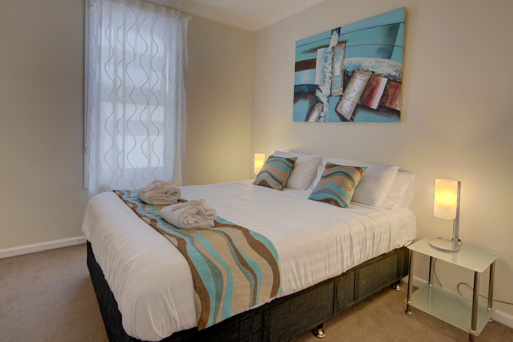 Bedroom 1 with comfortable queen size bed. The linen is hotel quality and commercially laundered