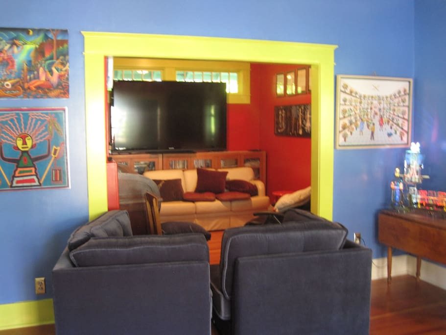 large screen TV , comfortable seating, lively art-open to all.