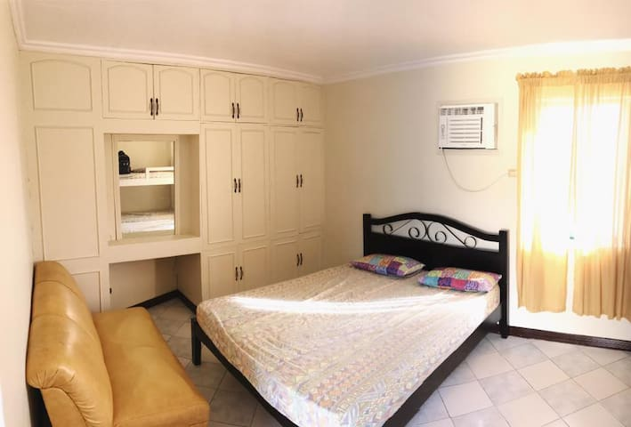 This is 1 of the 3 rooms. This is the air conditioned master bedroom with a shower room.
