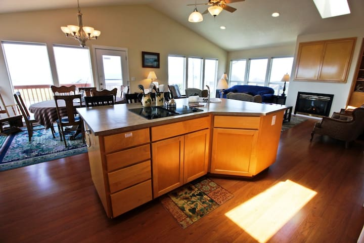 Fully equipped kitchen with all appliances, large prep island with sink, breakfast bar for three with spectacular ocean views.