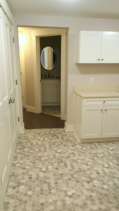 Laundry room and hallway to bathroom.