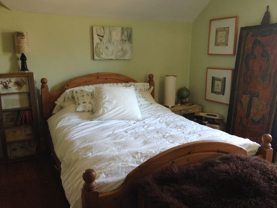 Queen bed in master bedroom.