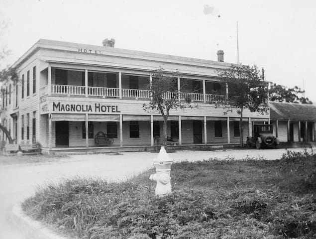 This is what the Magnolia Hotel once looked like during its prime as a frontier hotel. The balcony was removed around 1930.
