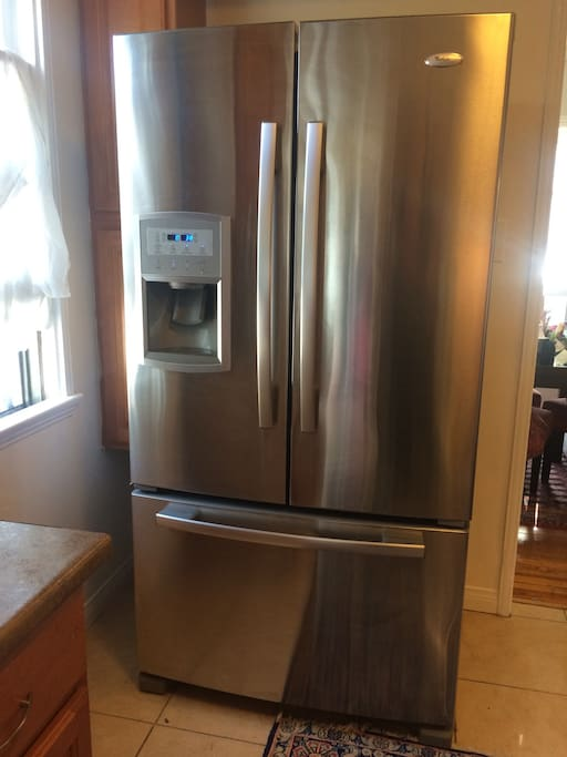 Full kitchen amenities including refrigerator with water/ice, dishwasher, stove, toaster oven and percolator coffee pot.