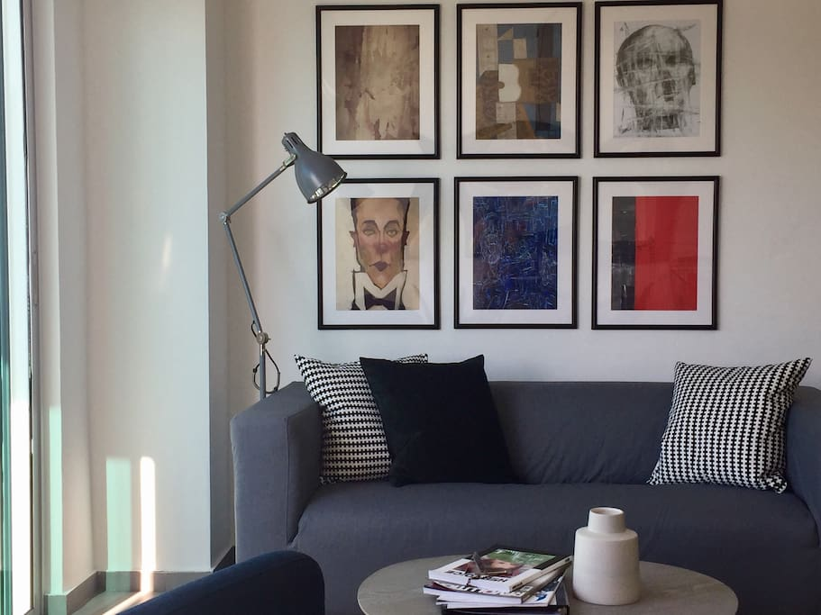 cozy sofa with wall art gallery to spend the afternoon reading a book.