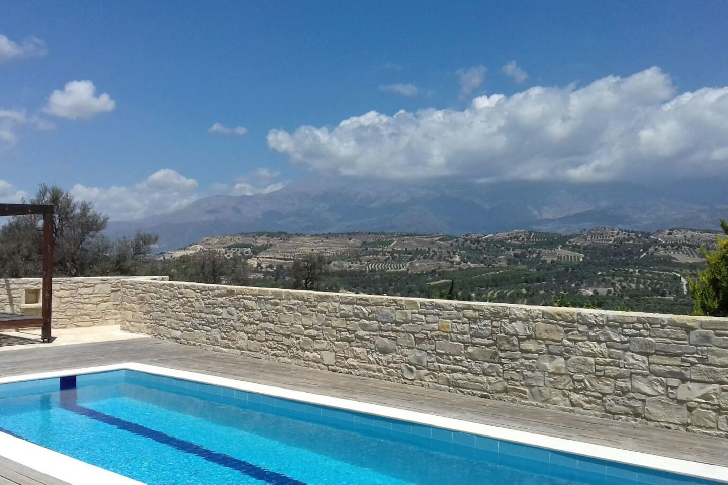 psiloritis and festos palace behind the pool