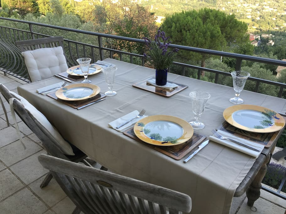 2nd floor balcony with dining table with views of South of France and ocean.