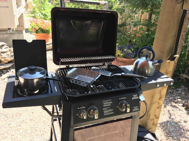 Grill with a pot and veggie griller plus tools for food prep and grilling