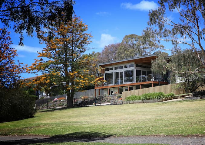 Looking towards the house from the lake shore.  The accommodation is on the ground floor and Don and Kerrie live above. Your accomodation has a separate entry, complete privacy and a magnificent view.