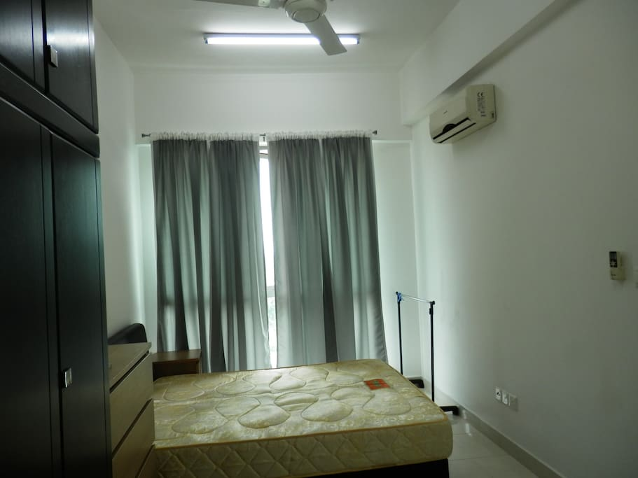Master bedroom with attached bathroom ,aircon,ceiling fan and full bedset