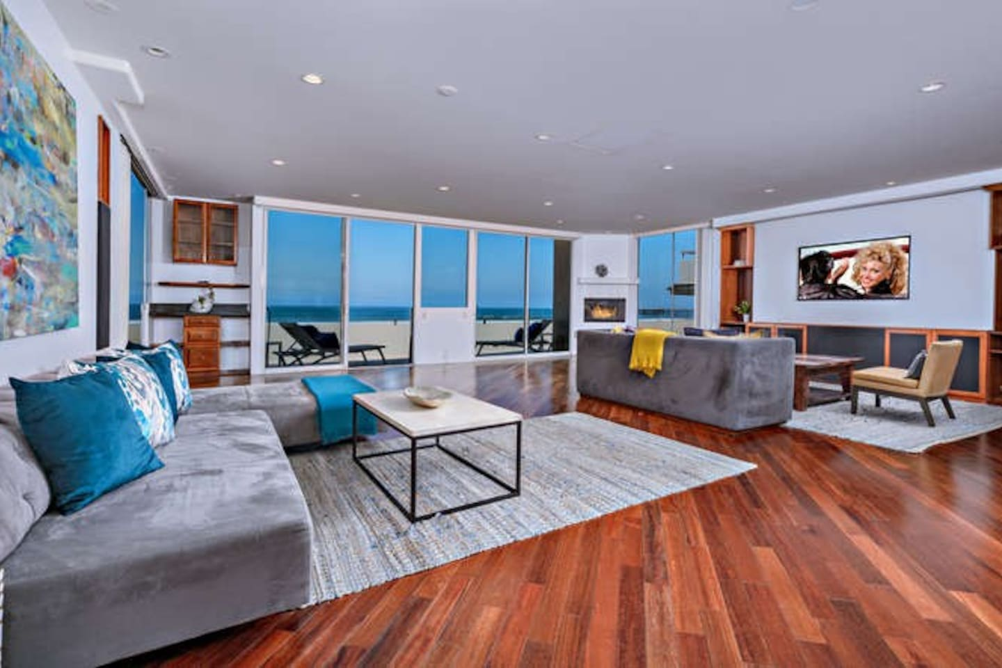 Living room area with plenty of seating to relax and enjoy ocean view.