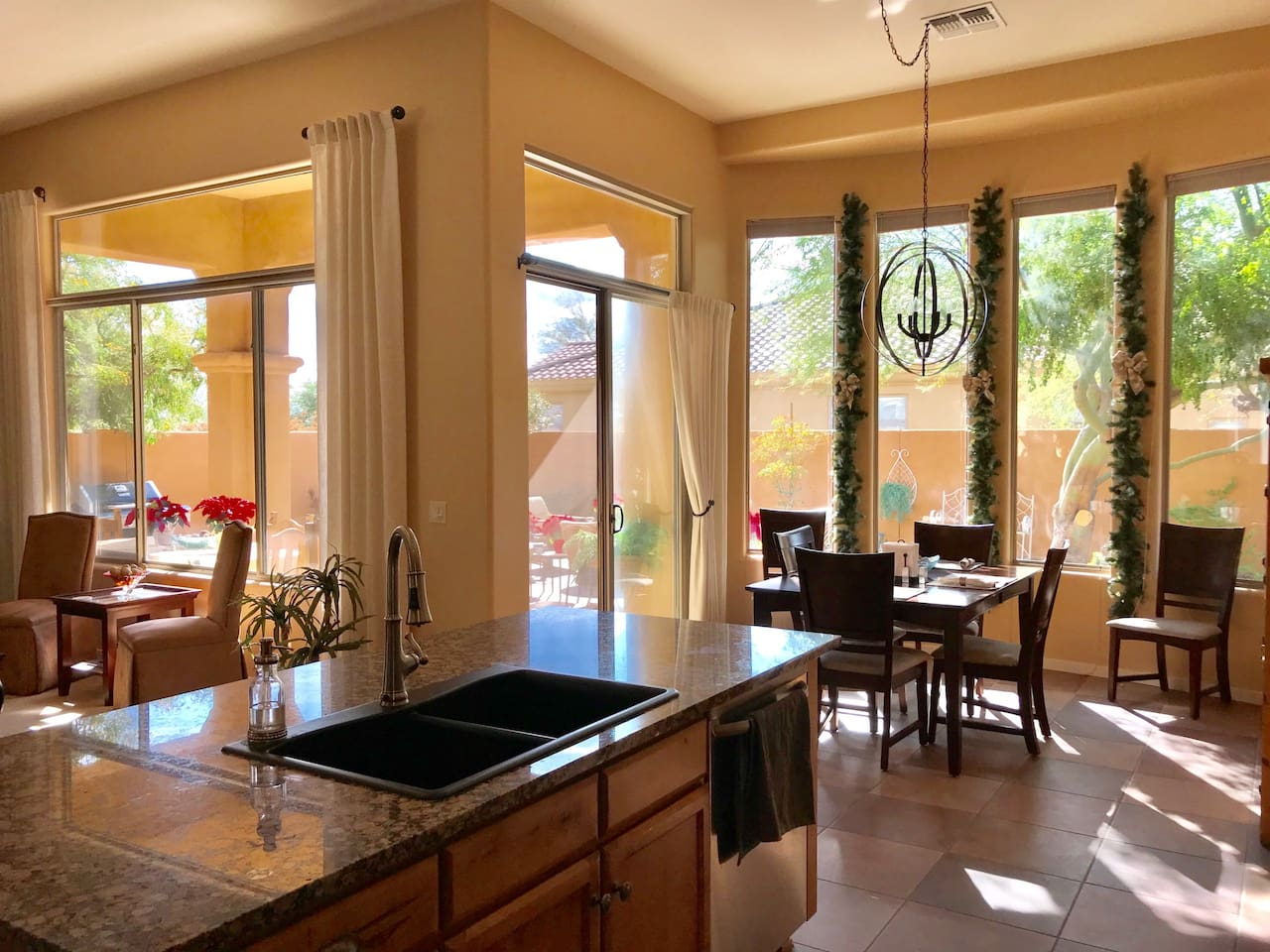 Open, bright family room and kitchen view to outdoor backyard living space. Kitchen table can be opened to seat 6 or 8 people with plenty of space around.