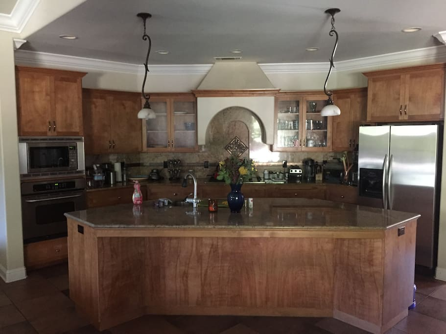 Huge kitchen with large island that is connected to the main living room. Great for entertaining.