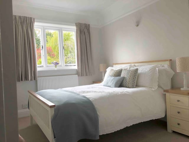 Double bedroom overlooking the garden, has a built in cupboard and chest of drawers