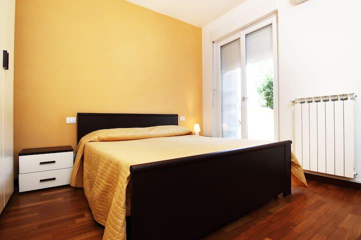 Appartamento con giardino e garage!