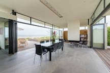 Dining area with beach beyond