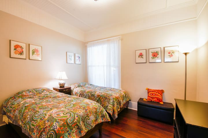 Second bedroom features two twin beds.