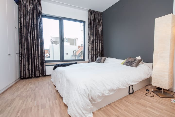 """Master Bedroom with a big bed (180x220cm)  POV: The photographer is standing in the doorway, with his back to the """"artsy half wall"""" as seen in the first picture.  Close the bedroom door and it will get so quiet. Even with the bedroom window tilted!"""