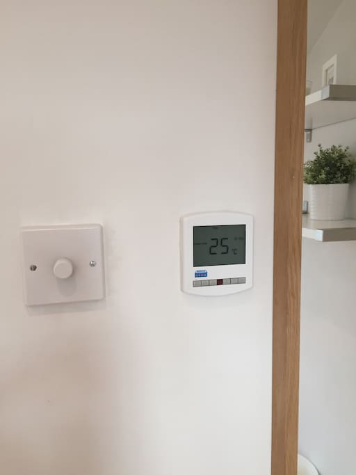 Dimmer switch controls overhead lighting & temperature controls control heat