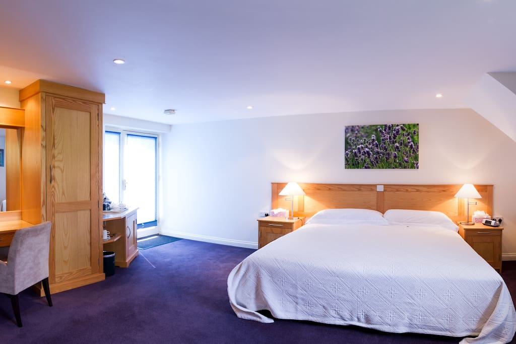 Lavender room with king size bed + double whirlpool bath.