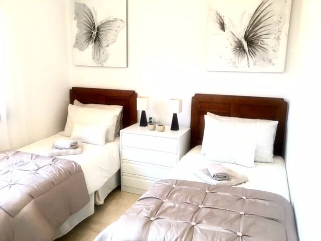 Further twin bedroom with built in wardrobes and hot and cold Air Con