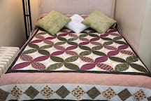 Second floor bedroom with double bed sleeps 2 people. Bed is made up with fresh linens & comforter.