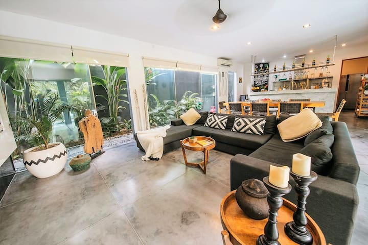 Living/dining room has direct pool access and flanked by garden