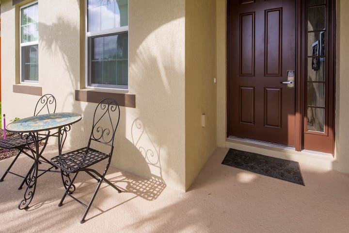 The covered porch area at the entrance to this beautiful vacation home is a great place to spend your early morning, sipping coffee and watching the Florida sky light up.