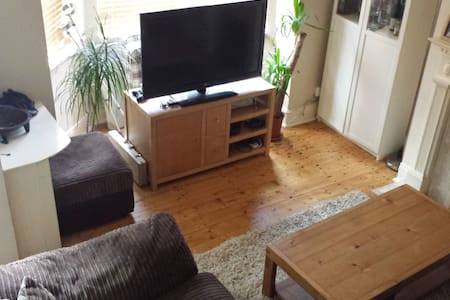 Spacious corner couch in front room - Prestwich