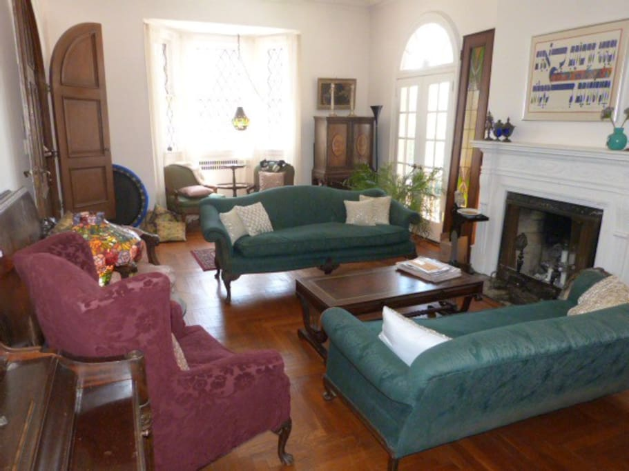 This relaxing living room has comfortable couches, bay windows and a fantastic ambiance.