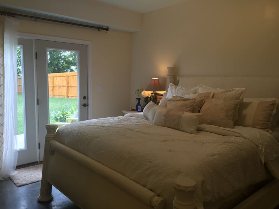 King Bed and private patio.  All the floors are concrete which keeps clean up easy.