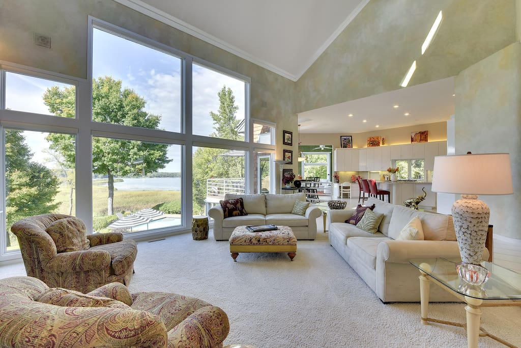 Comfortable living room--open floor plan and fabulous views of lake and pool