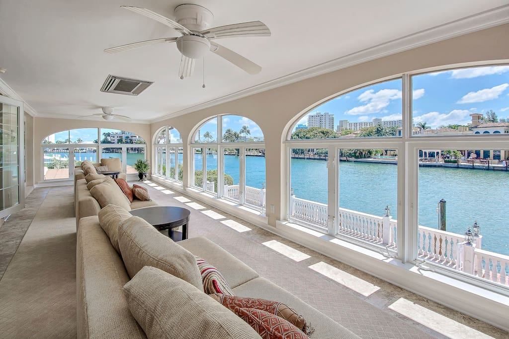 A sunny room filled with comfy couches and gorgeous views across the Intracoastal Waterway
