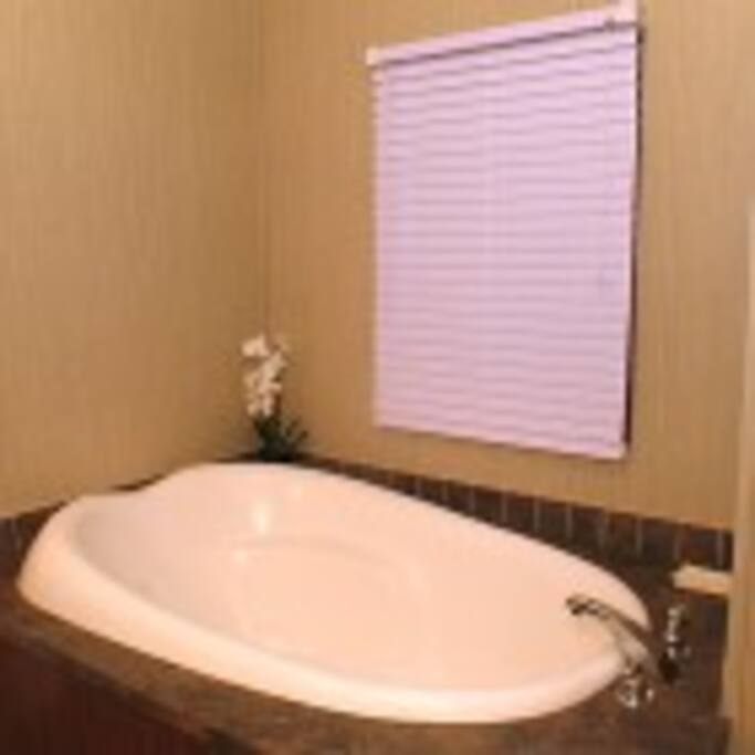 Bathtub in king suites, large cabins