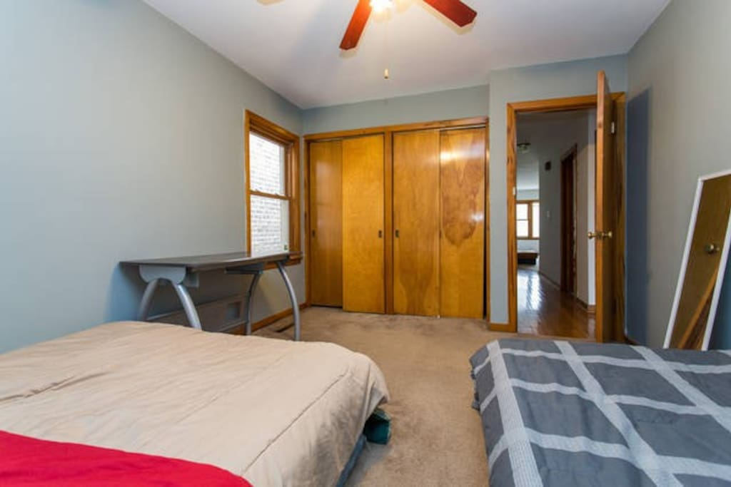 The shared bedroom.  This listing is for the Queen bed only.