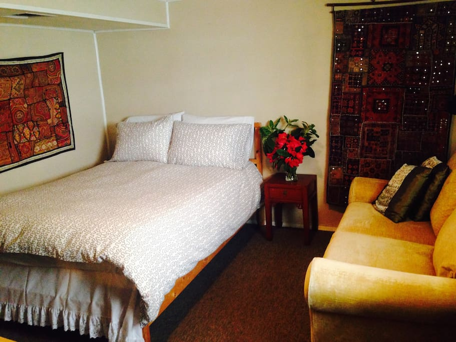 Comfortable double bed in a spacious room.