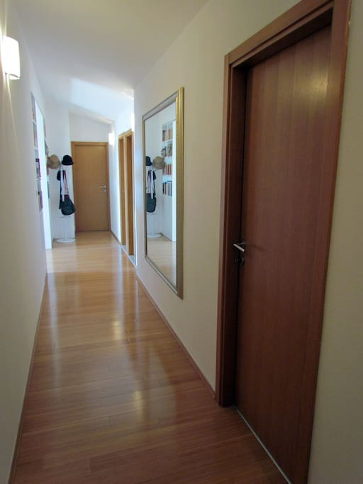 The rooms are on western/eastern side of the house and in the corridor there is a huge mirror (full size).