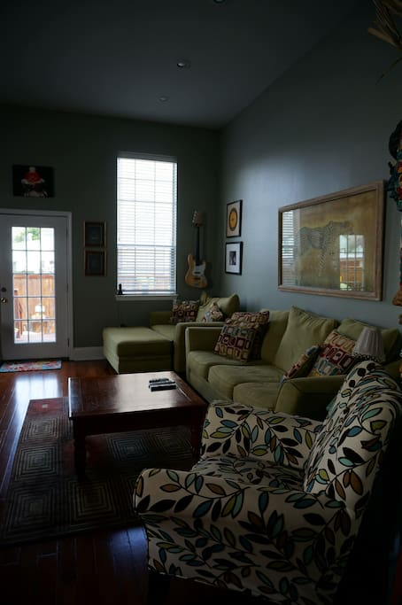Open living room with lots of light, large screen tv